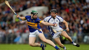 Tipperary's Brian O'Meara takes the ball past Kevin Moran of Waterford in the Munster final
