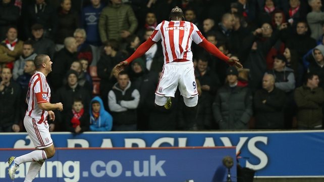 Kenwyne Jones celebrates his goal as fellow goalscorer Jon Walters looks on