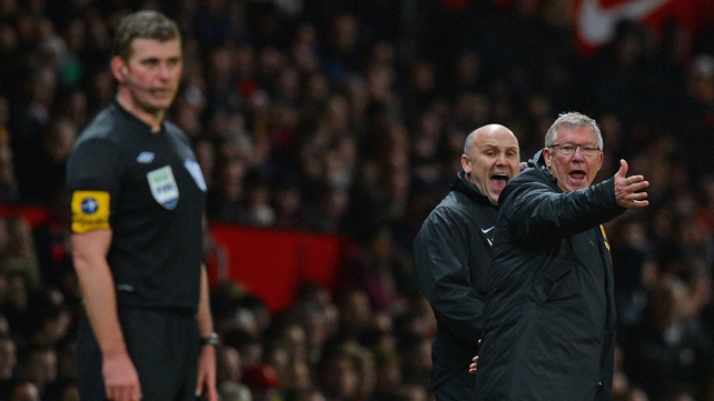 Alex Ferguson and his assistant Mike Phelan gesture to assistant referee Jake Collin during Man United's clash with Newcastle