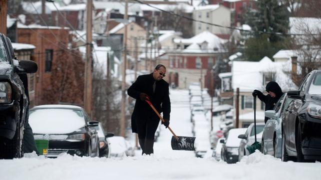 Residents shovel snow on Mt. Washington in Pittsburgh, Pennsylvania