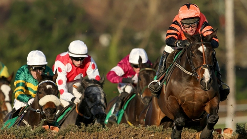 Jezki ridden by Robbie Power clears the last to win the Paddy Power Future Champions Novice Hurdle
