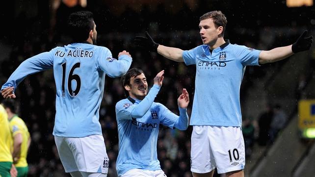 Sergio Aguero and David Silva rush to congratulate goal scorer Edin Dzeko