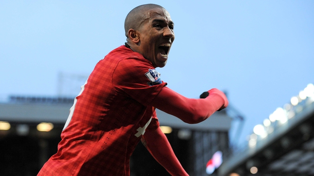 Ashley Young celebrates United's opener