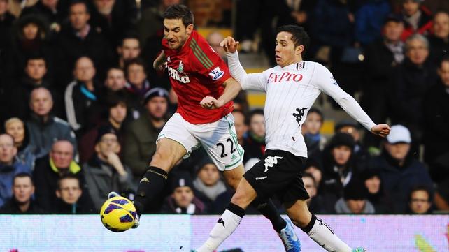 Swansea's Angel Rangel evades Fulham's Bryan Ruiz