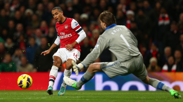 Hat-trick hero Theo Walcott strokes the ball past Tim Krul in the Newcastle goal