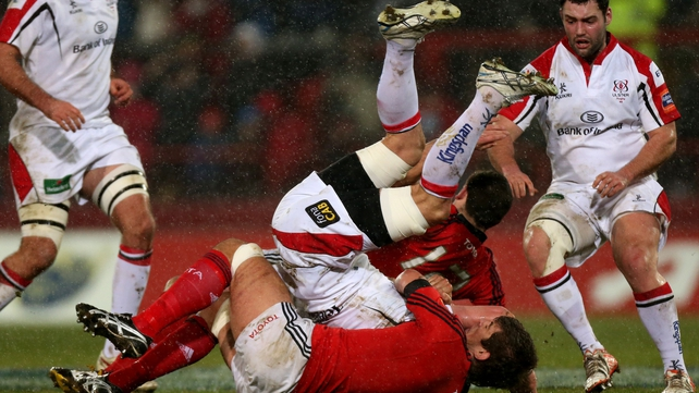 Munster's Donncha O'Callaghan and James Downey get to grips with Ulster's Robbie Diack
