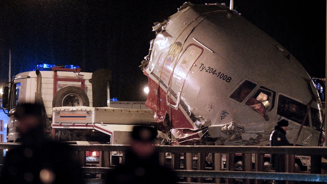 A truck removes the cabin of the Tu-204 jet from its crash site