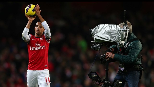 Theo Walcott paraded the match ball around the Emirates at full-time