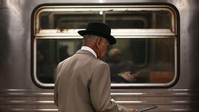 A man wait for a subway train in Manhattan