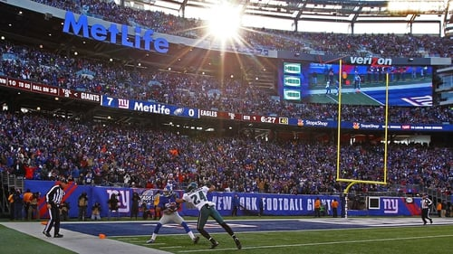 Too little, too late: The New York Giants' Rueben Randle catches a touchdown pass during the win at Metlife Stadium, but his side's indifferent form during the regular season means they miss the play-offs