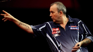 Phil Taylor survived a fightback from Raymond van Barneveld to reach
