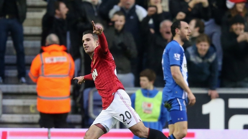 Robin van Persie celebrates after scoring his first at the DW