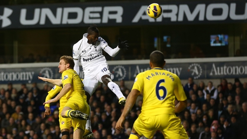 Emmanuel Adebayor of Tottenham scores against Reading
