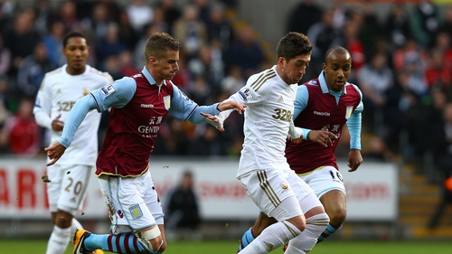 Pablo Hernandez of Swansea City battles with Andreas Weimann of Aston Villa