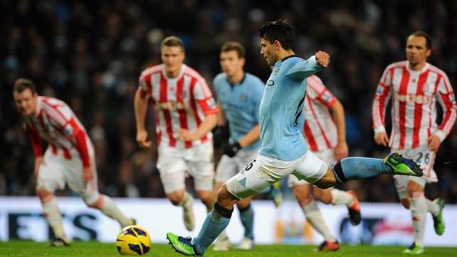 Sergio Aguero of Manchester City scores from a penalty against Stoke
