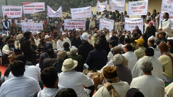 Protesters braved chilly weather in New Delhi to hold candlelight vigils