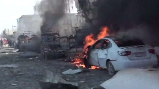 A video posted online by activists showed dozens of vehicles on fire