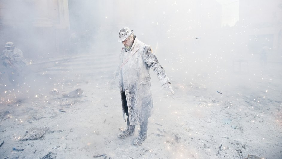 A reveller takes part in the battle of Enfarinats, a flour fight in celebration of the Els Enfarinats festival in Ibi, Spain