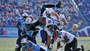 Richard Murphy (39) of the Jacksonville Jaguars is tackled by Tommie Campbell (37) and Al Afalava (38) of the Tennessee Titans