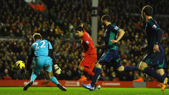 Luis Suarez scores Liverpool's third goal at Anfield