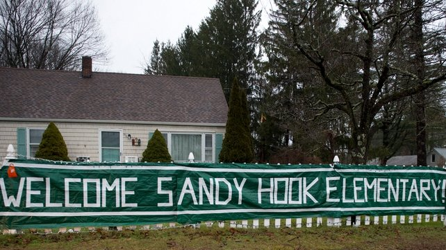 A sign near Chalk Hill school greets students from Sandy Hook