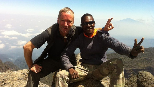 Ian McKeever pictured with a guide on Mount Kilimanjaro in July (Pic: Facebook)