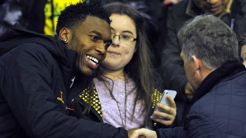 Daniel Sturridge is greeted by a fan at Anfield last night