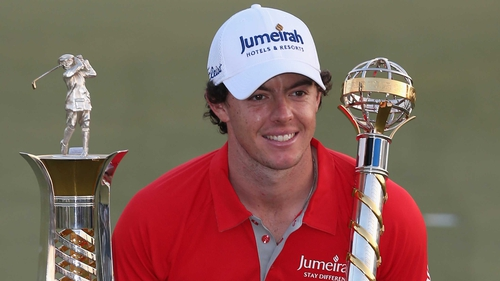 Rory McIlroy shows off the season-ending DP World Tour Championship and The Race to Dubai trophies
