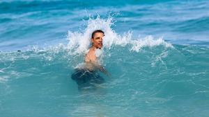 Barack Obama jumps into the ocean at Pyramid Rock Beach in Kaneohe Bay, Hawaii