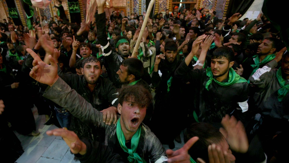Iraqis take part in the Arbaeen religious festival in the shrine city of Karbala, southwest of Iraq's capital Baghdad