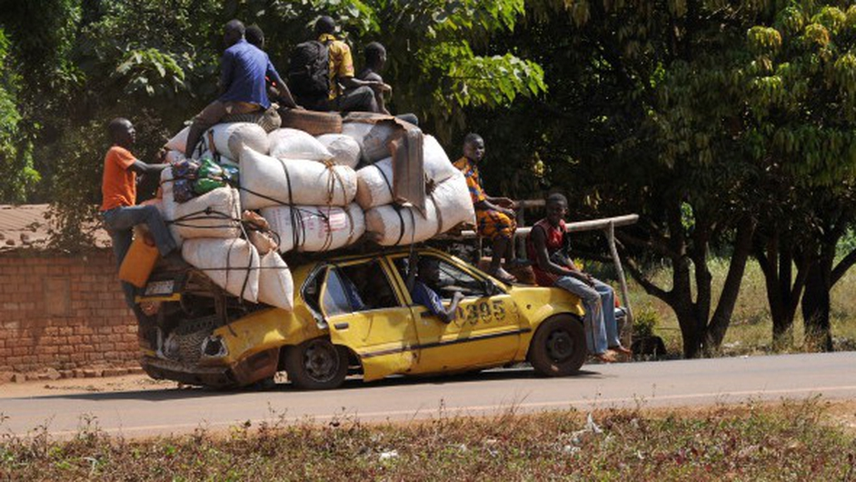 People leave the Central African Republic town of Damara, the last strategic town between the rebels from the SELEKA coalition and the country's capital Bangui