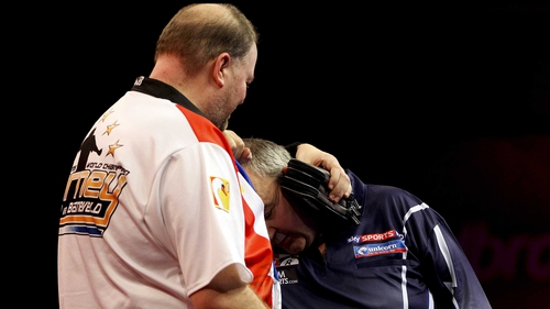 Phil Taylor and Raymond van Barneveld were involved in an exchanged after their semi-final match