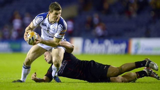 Leinster's Brian O'Driscoll eludes grasping Edinburgh centre Ben Atiga