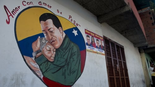 Picture of a wall with an image of Venezuelan President Hugo Chavez