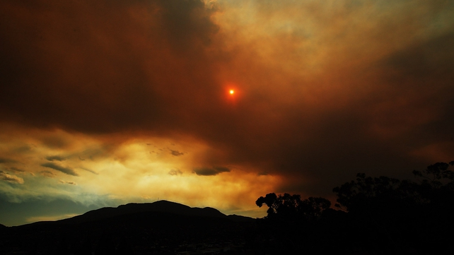 Clouds from a nearby bushfire are seen over Mount Wellington is Tasmania