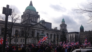 Several hundred people gathered outside Belfast City Hall yesterday