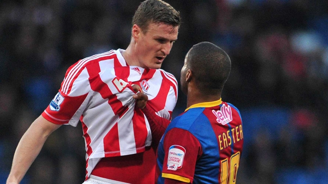 Crystal Palace's Welsh striker Jermaine Easter (R) clashes with Stoke's Robert Huth