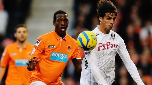 Isaiah Osbourne (l) of Blackpool challenges Bryan Ruiz of Fulham