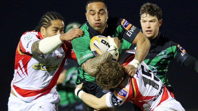 Dragons' Andy Tuilagi and Hallam Amos tackle Fetu'u Vainikolo of Connacht
