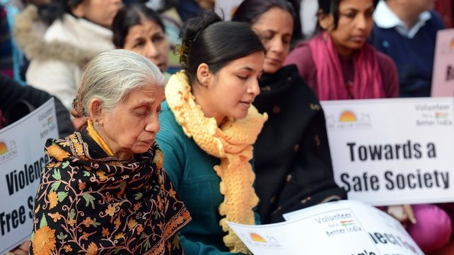 Indian protesters participate in a prayer meeting for the rape victim in New Delhi yesterday