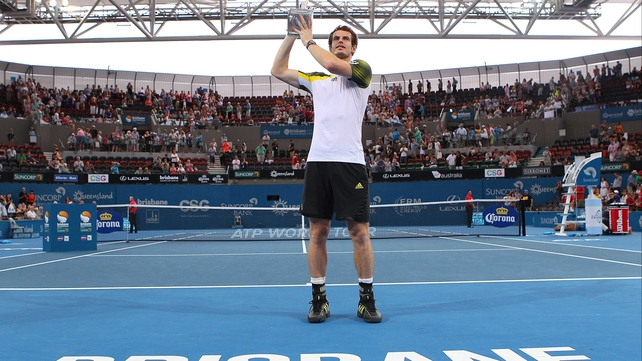Andy Murray holds aloft the Brisbane International trophy for the second consecutive year