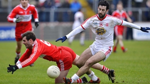 Tyrone's Jonathan Lafferty and Mark Lynch of Derry tussle for possession