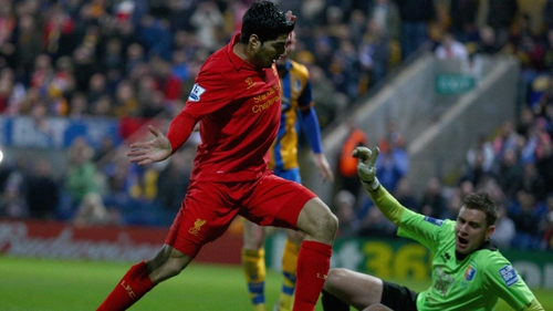 Luis Suarez scored Liverpool's second goal in a controversial manner