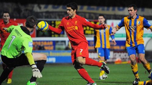 Luis Suarez scoring Liverpool's winning goal against Mansfield Town