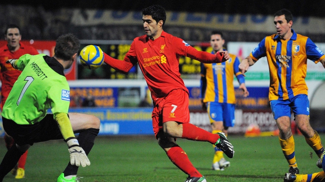 Luis Suarez scoring Liverpool's winning goal against Mansfield Town