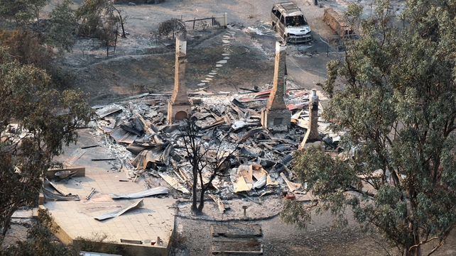 This aerial photograph shows the devastated town of Dunalley after bush fires swept through the area