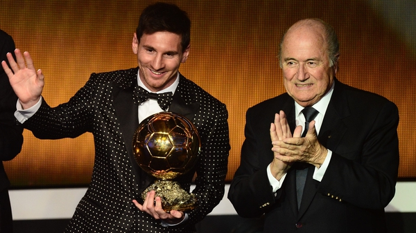 Lionel Messi pictured with Sepp Blatter - great footballer, shame about the suit