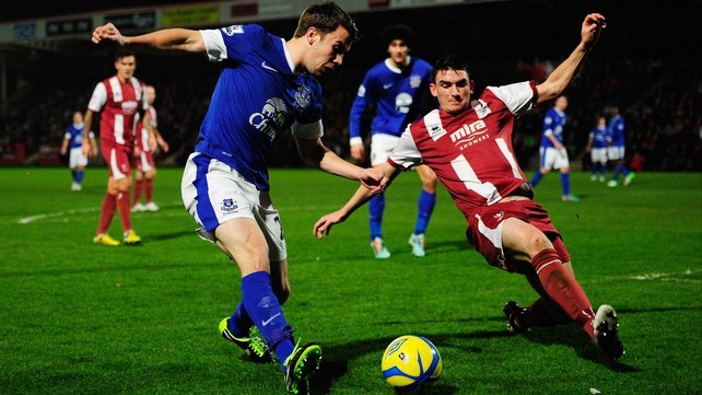 Seamus Coleman of Everton is faced by Billy Jones of Cheltenham Town