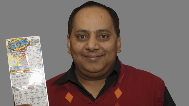 Urooj Khan posing with the winning ticket