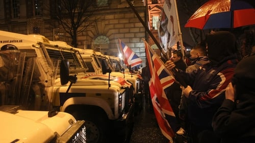 Police were out in force as loyalists demonstrated outside Belfast City Hall last night